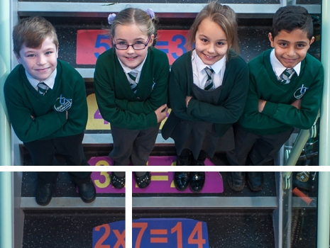 Pupils on the stair wall graphics at River View Primary School