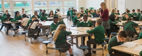 A group of pupils working in the school hall at River View Primary School