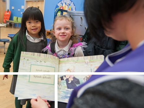 A teacher reading to two pupils at River View Primary School