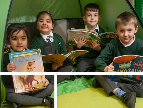 Pupils reading in a tent at River View Primary School