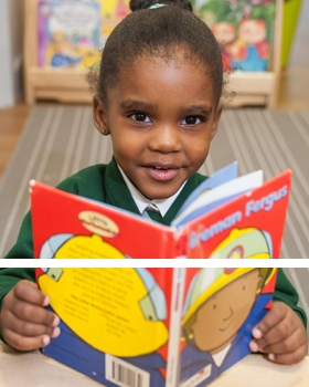 A pupils reading a book at River View Primary School