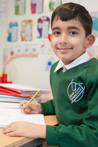 A pupil working in a classroom at River View Primary School