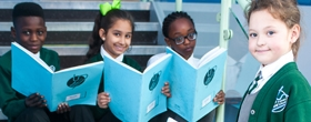 Pupils with books at River View Primary School