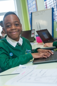 A pupil working on a computer at River View Primary School