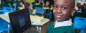 A pupil studying on a computer at River View Primary School