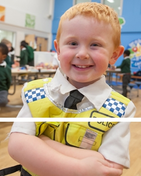 A pupil dressed as a police officer at River View Primary School