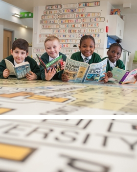 A group of pupils reading at River View Primary School