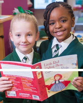 Two pupils reading a book together at River View Primary School