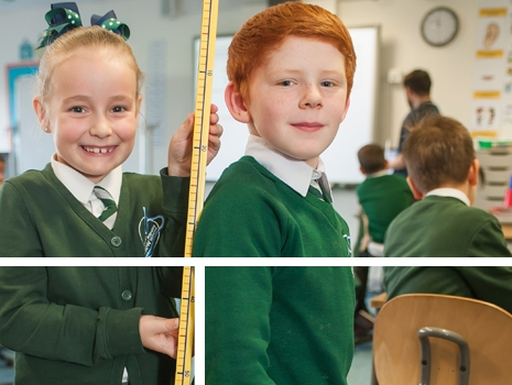 Pupils measuring each others height with a tape measure at River View Primary School
