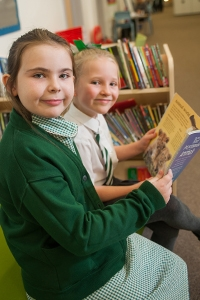 Pupils reading a book at River View Primary School