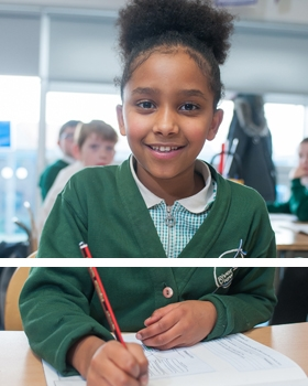 A pupil writing in a lesson at River View Primary School