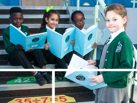 Pupils reading on the stairs at River View Primary School