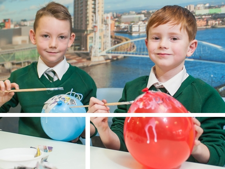 Pupils making paper mache in a lesson at River View Primary School